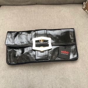 Hobo international clutch patent leather